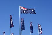 Austrlian Flag and Vivid Sydney 2017 flags against a blue sky