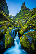 Moss, rocks, and cascading water at Thakgil Canyon