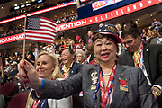 A GOP delegate waves a flag during the Republican National Convention July 20, 2016 in Cleveland, Ohio.