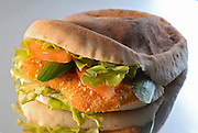breaded Chicken escalope (Schnitzel) in a pita with salad
