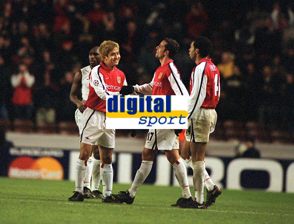 Fotball: Junichi Inamoto, Arsenal, celebrates with his team mates,Edu and Henry. Arsenal v Bayer Leverkusen. Champions League. 27.2.2002.<br /><br />Foto : Andrew Cowie/Digitalsport