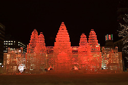 Illuminated ice sculpture of Angkor Wat temple at annual Ice and snow sculpture festival in Sapporo Japan