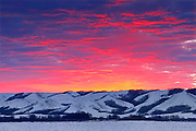 Dawn light on the hills of the Qu' Appelle Valley in winter<br /> near Craven <br /> Saskatchewan<br /> Canada