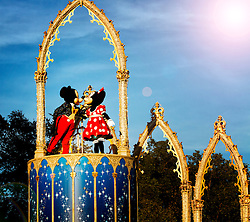 Mickie and Minnie kissing at the Magical Kingdom on the night of the Halloween festivities.