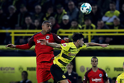 DORTMUND, March 12, 2018  Mahmoud Dahoud (R) of Dortmund vies with Kevin-Prince Boateng of Frankfurt during the German Bundesliga soccer match between Borussia Dortmund and Eintracht Frankfurt in Dortmund, Germany, on March 11, 2018. Dortmund won 3-2. (Credit Image: © Joachim Bywaletz/Xinhua via ZUMA Wire)