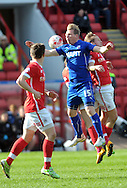Luke Berry of Barnsley collides with RitchieHumphreys of Chesterfield during the Sky Bet League 1 match at Oakwell, Barnsley<br /> Picture by Graham Crowther/Focus Images Ltd +44 7763 140036<br /> 11/04/2015