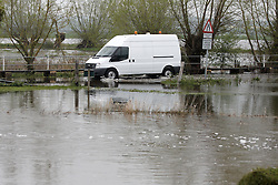 © Licensed to London News Pictures.  02/05/2012. THAME, UK. The Thame River bursts its banks at .Shabbington, Oxfordshire following days of heavy rain. A number of flood alerts remain in force across the region. Photo credit :  Cliff Hide/LNP