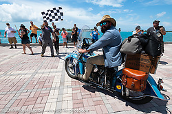 Evan Riggle riding his 1942 Indian 4-cylinder in the Cross Country Chase motorcycle endurance run from Sault Sainte Marie, MI to Key West, FL. (for vintage bikes from 1930-1948). The Grand Finish in Key West's Mallory Square after the 110 mile Stage-10 ride from Miami to Key West, FL and after covering 2,368 miles of the Cross Country Chase. Sunday, September 15, 2019. Photography ©2019 Michael Lichter.