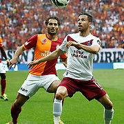 Galatasaray's Hamit Altintop (L) during their Turkish superleague soccer derby match Galatasaray between Trabzonspor at the AliSamiYen spor kompleksi TT Arena in Istanbul Turkey on Saturday, 18 May 2013. Photo by Aykut AKICI/TURKPIX