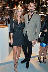 LONDON, ENGLAND 8 DECEMBER 2016: Millie Mackintosh, Hugo Taylor at a party to celebrate the collaboration of Taylor Morris Eyewear and The Morgan Motor Company held at Harvey Nichols, Knightsbridge, London, England. 8 December 2016.
