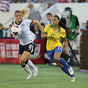 U.S. defender Kristie Mewis (8) and Brazil forward Nene (17) chase the ball during a women's soccer International friendly match between Brazil and the United States National Team, at the Florida Citrus Bowl  on Sunday, November 10, 2013 in Orlando, Florida. The U.S won the game by a score of 4-1.  (AP Photo/Alex Menendez)