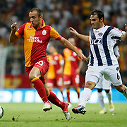 Galatasaray's Sercan Yildirim (L) and Kasimpasa's Abdurrahman Dereli during their Turkish Super League soccer match Galatasaray between Kasimpasa at the TT Arena at Seyrantepe in Istanbul Turkey on Monday 20 August 2012. Photo by TURKPIX
