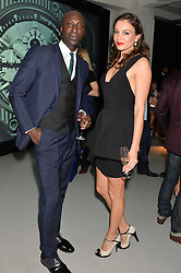OZWALD BOATENG and MICHELLE TAGLIANI at the Audemars Piguet Royal Oak Offshore 42mm Party held at Victoria House, Bloomsbury Square, London on 23rd April 2014.