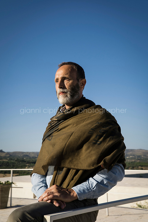 """NOTO, ITALY - 20 JUNE 2020: Jeweller Fabio Salini poses for a portrait on the rooftop of his Sicilian villa, where he retreats as oftens as he can, in the countryside of Noto, Sicily, Italy, on June 20th 2020. Fabio Salini produces his own olive oil.<br /> <br /> """"I consider jewellery to be an expression of art. It has to be based not just on an aesthetic achievement but also on concept,"""" says Salini, who cut his teeth fashioning spectacular baubles for the likes of <br /> Bulgari<br />  and <br /> Cartier<br /> , and continued to design for major houses after opening his swish atelier in Rome in 2004."""