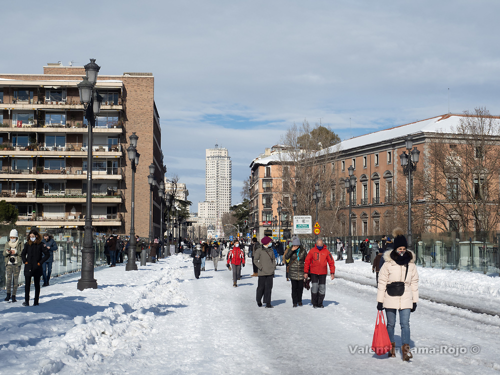 Madrid, Spain. 10th January, 2021. People walking at Bailen street the day after storm Filomena hitted Madrid. After Storm Filomena, Madrid (Spain) is covered in snow and ice, lots of trees have fallen and it is not possible to use the car in most of the streets but people walk around the city. © Valentin Sama-Rojo.