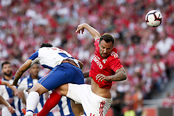 October 7, 2018 - Lisbon, Portugal - Haris Seferovic of Benfica (R) heads for the ball with Tiquinho Soares of Porto (L)  during the Portuguese League football match between SL Benfica and FC Porto at Luz Stadium in Lisbon on October 7, 2018. (Credit Image: © Carlos Palma/NurPhoto/ZUMA Press)