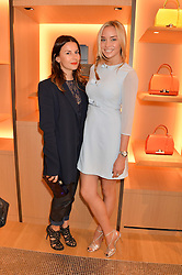Left to right, JULIET ANGUS and NOELLE RENO at the opening party for Moynat's new Maison de Vente in Mayfair at 112 Mount Street, London W1 on 12th March 2014.