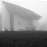 Ronchamp, France, Belfort, 1989: View of the Chapel Notre Dame du Haut (1946)- Le Corbusier arch - Visit Shop Images to purchase and download a digital file and explore other AS images archive. Photographs by Alejandro Sala