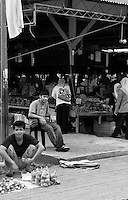 A hawker sits outside the waterfront market in Kota Kinabalu.