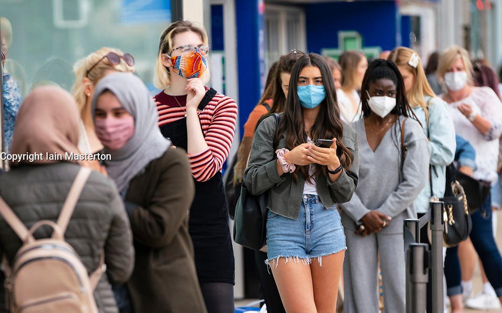 Edinburgh, Scotland, UK. 24 July, 2020. Social distancing in queue by customers wearing facemark outside Zara on Princes Street in Edinburgh. Iain Masterton/Alamy Live News