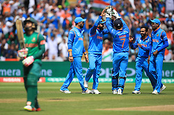 India players celebrate as Bangladesh's Shakib Al Hasan leaves the field after being caught by MS Dhoni during the ICC Champions Trophy, semi-final match at Edgbaston, Birmingham.
