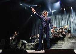 © Licensed to London News Pictures. 17/03/2015. London, UK.   Spandau Ballet performing live at The O2 Arena.   In this picture - Tony Hadley (centre), Martin Kemp (left). Spandau Ballet are a British new wave band formed in London in the late 1970s, composed of members Tony Hadley (lead vocals, synthesisers), Gary Kemp ( guitar, keyboards, backing vocals), Steve Norman (saxophone, guitar, percussion), John Keeble –(drums, backing vocals), <br /> Martin Kemp (bass).  Photo credit : Richard Isaac/LNP