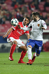 December 5, 2017 - Lisbon, Portugal - Benfica's Portuguese midfielder Joao Carvalho (L) vies with Basel's midfielder Renato Steffen from Suisse during the UEFA Champions League Group A football match between SL Benfica and FC Basel at the Luz stadium in Lisbon, Portugal on December 5, 2017. (Credit Image: © Pedro Fiuza/NurPhoto via ZUMA Press)