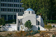 A whitewashed Greek Orthodox church in Athens, Greece