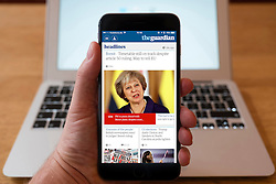 Using iPhone smartphone to display headlines from The Guardian UK newspaper