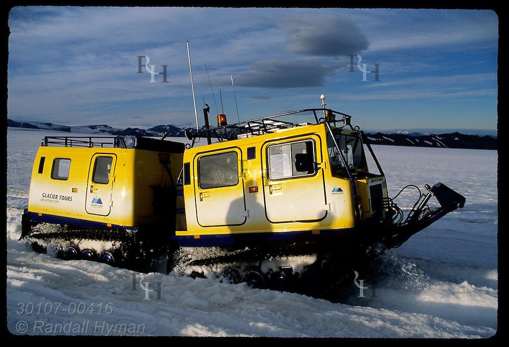 Glacier Tours snowbus takes passengers on two-hour trip atop Vatnajokull glacier; southeast Iceland.