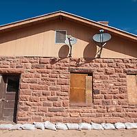 091813        Brian Leddy<br /> A home remains sandbagged in Zuni Wednesday.