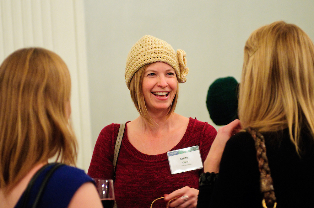 FTI Consulting Managing Director Kristen N. Litgen shows off her new handmade hat purchased during a holiday bazaar hosted by the women of Faegre Baker Daniels LLP at the W Chicago City Center Hotel on Thursday, November 29th. The second annual event features 25 booths featuring female entrepreneurs, artisans and artists. © 2012 Brian J. Morowczynski ViaPhotos
