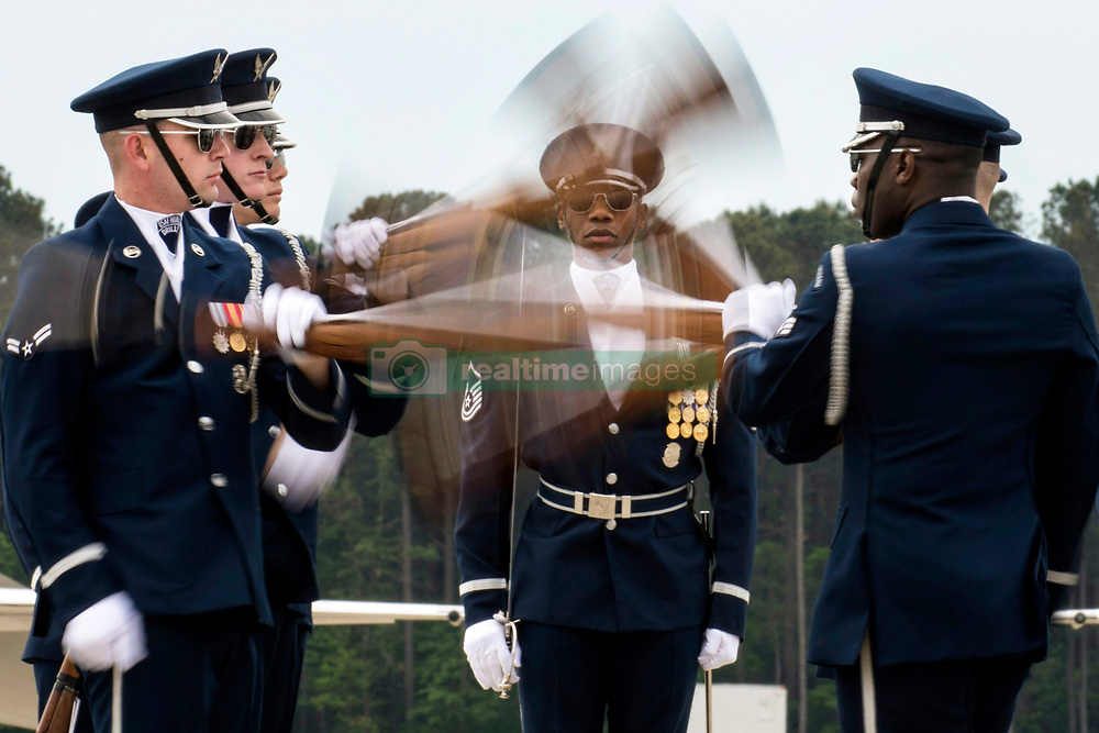 A U.S. Air Force Honor Guard Drill Team member<br /> <br /> walks through a gauntlet as other members of<br /> <br /> the team exchange rifles during the Wings Over<br /> <br /> Wayne Airshow, April 28, 2019, at Seymour<br /> <br /> Johnson Air Force Base, North Carolina. The<br /> <br /> Honor Guard endorses the Air Force mission<br /> <br /> through its precise drill performances aimed at<br /> <br /> retaining, recruiting and inspiring Airmen.