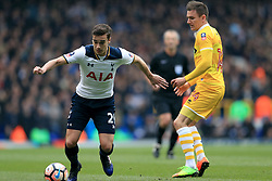 Tottenham Hotspur's Harry Winks (left) and Millwall's Jed Wallace (right) battle for the ball