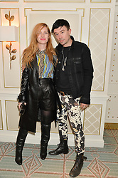 JOSEPHINE DE LA BAUME and ROBBIE FURZE at the launch of Mrs Alice in Her Palace - a fashion retail website, held at Fortnum & Mason, Piccadilly, London on 27th March 2014.