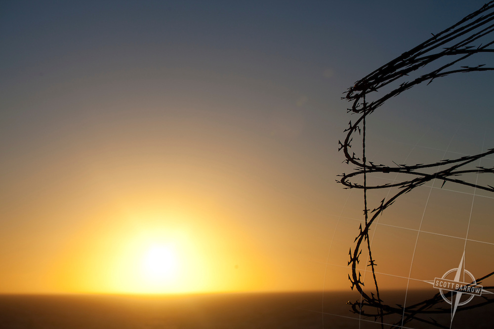 Razor wire at sunset, sunrise.