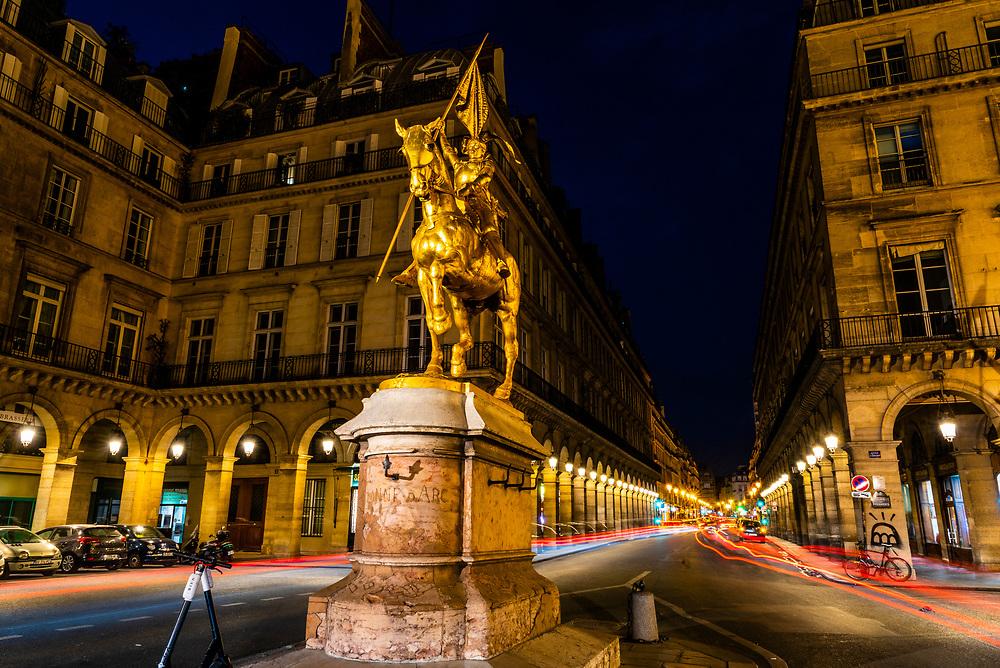 """Statue """"Jeanne d'Arc Paris"""" (Joan of Arc) a gilded bronze equestrian sculpture by Emmanuel Fremiet (1874) sits in Place des Pyramides, Paris, France."""