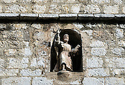 Church wall crevice with sculptue figure of the apostle St Paul, St Paul de Vence, Provence, France