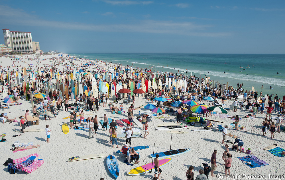 A couple thousand people attended the Yancy Spencer III Memorial Paddle Out  on Pensacola Beach in Pensacola Fla., Sunday, February 20, 2011.  Spencer, 60,  of Gulf Breeze, Fla was the owner of Innerlight Surf and Skate. He died while surfing in California and is considered the father of Gulf Coast surfing.  A few hundred surfers brought their boards for a paddle-out, in which they formed a circle in the Gulf to share stories about the late surfing legend. Spencer, a legendary Gulf Coast surfer, died of an apparent heart attack in California on Monday while sitting on the beach after catching waves at County Line, his favorite spot on Malibu Beach.  (Michael Spooneybarger)