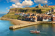 Whitby harbour with Whitby Abbey on the headland . Whitby, North Yorkshire, England .<br /> <br /> Visit our ENGLAND PHOTO COLLECTIONS for more photos to download or buy as wall art prints https://funkystock.photoshelter.com/gallery-collection/Pictures-Images-of-England-Photos-of-English-Historic-Landmark-Sites/C0000SnAAiGINuEQ