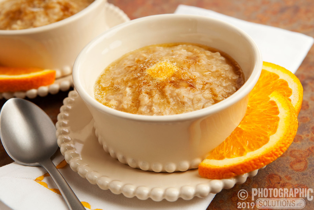 Hot oatmeal with butter, cinnamon and a side of oranges