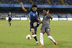October 14, 2017 - Kolkata, West Bengal, India - Japan Hiroto Yamada and New Caledonia Sidri Wadenges during the Japan and New Caledonia Group E match in Kolkata. Player of Japan and New Caledonia in action during the FIFA U 17 World Cup India 2017 Group F match on October 14, 2017 in Kolkata. (Credit Image: © Saikat Paul/Pacific Press via ZUMA Wire)
