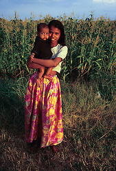 India, Rajasthan. Young Hindu woman (15 years old) with baby boy