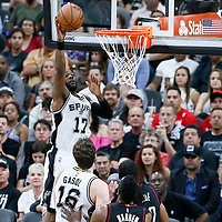 03 May 2017: San Antonio Spurs guard Jonathon Simmons (17) goes for the layup during the San Antonio Spurs 121-96 victory over the Houston Rockets, in game 2 of the Western Conference Semi Finals, at the AT&T Center, San Antonio, Texas, USA.