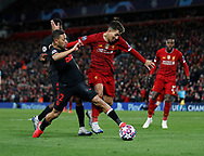 Roberto Firmino of Liverpool tackled by Renan Lodi of Atletico Madrid during the UEFA Champions League match at Anfield, Liverpool. Picture date: 11th March 2020. Picture credit should read: Darren Staples/Sportimage
