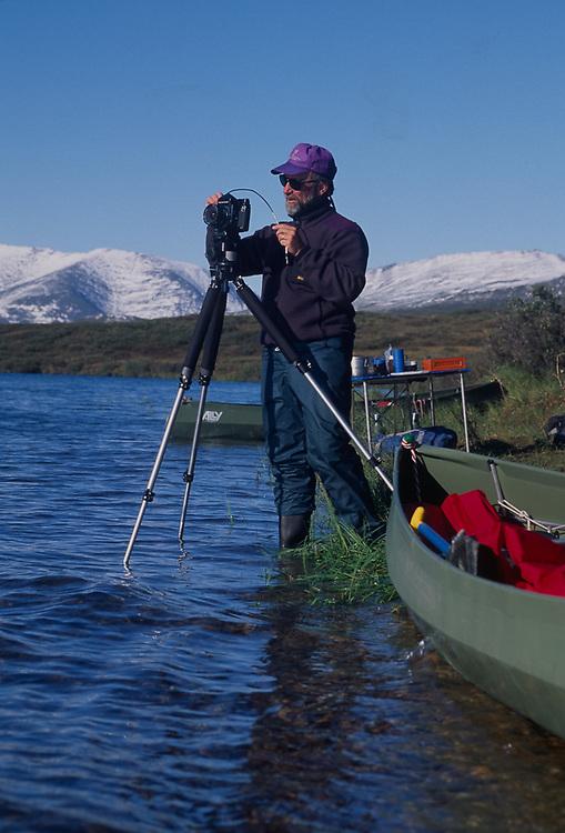 Pat O'Hara photographing, Matcharak Lake, Noatak River area, Gates of the Arctic Natinal Park, AK, USA