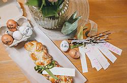 THEMENBILD - selbst beschriftete Ostereier, ein Osterstriezel, Servietten und Geschenksanhänger für Ostergeschenke liegen auf einem Tisch, aufgenommen am 10. April 2020, Oesterreich // self labeled Easter eggs, an easter bread, napkins and gift tags for Easter gifts are on a table, Austria on 2020/04/10. EXPA Pictures © 2020, PhotoCredit: EXPA/Stefanie Oberhauser