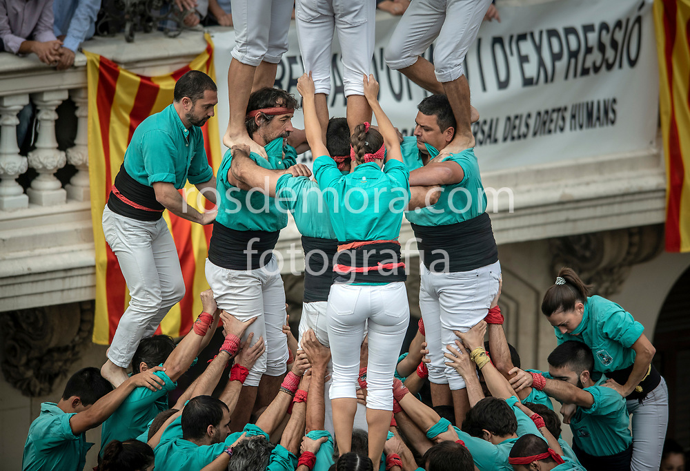 "Members of Castellers de Vilafranca build ""3 of 10 fm"" human tower of extreme difficulty in the last performance of the season in Vilafranca del Penedès,Barcelona, Spain. 1st Nov 2019."