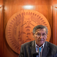 011315       Cable Hoover<br /> <br /> Ben Shelley stands in front of the Navajo Nation seal as he prepares to be sworn-in for an extended term Tuesday in Window Rock.
