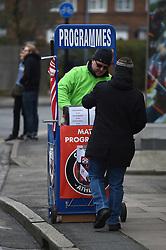 Programe seller outside The Valley
